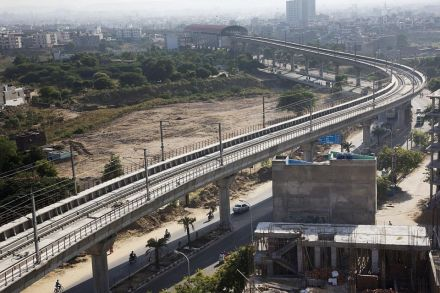 A yet-to-be operational Jaipur Metro Rail elevated track in Jaipur, Rajasthan, India. In all areas of infrastructure, except railroads, India is now trailing China.  PHOTO: BLOOMBERG
