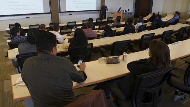 Students at a University of Pennsylvania's Wharton School lecture in San Francisco. Even if scholars agree on the importance of publishing in the popular media, the system plays against them. Publications in peer-reviewed journals continue to be the key performance indicator within academia: whether anyone reads them is a secondary consideration. PHOTO: BLOOMBERG