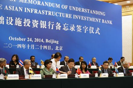 China's Finance Minister Lou Jiwei signs a document, with the guests of the signing ceremony of the Asian Infrastructure Investment Bank at the Great Hall of the People in Beijing.  PHOTO: REUTERS
